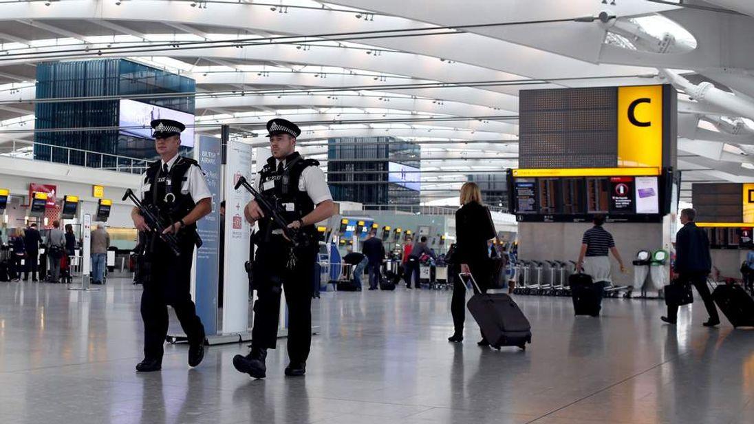 Armed police patrol at Heathrow Airport