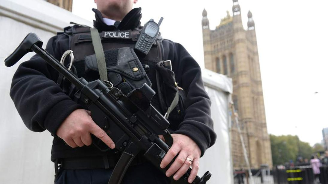 An armed Metropolitan police officer outside the Houses of Parliament.