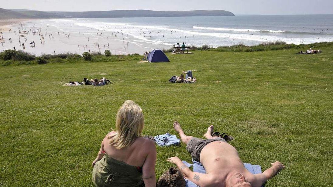 Two people sunbathing