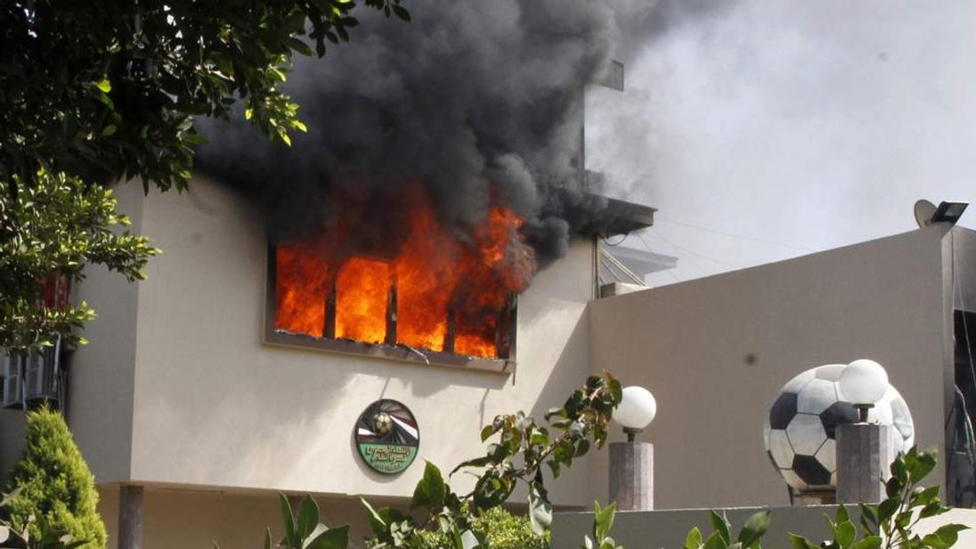 Flames rise from a room at the headquarters of the Egyptian Football Association in Cairo on March 9, 2013.