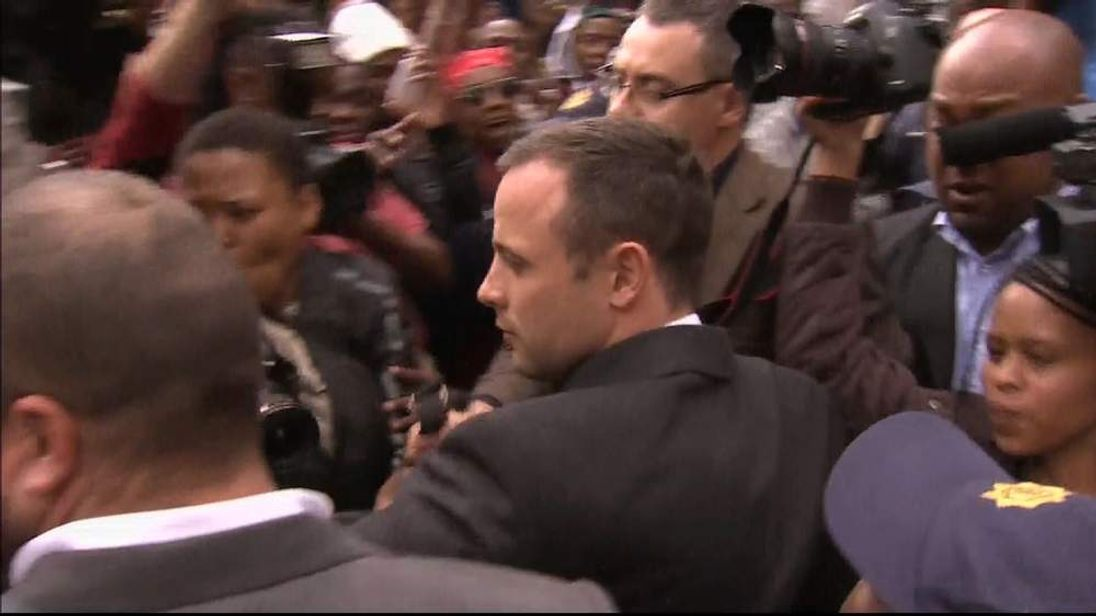 Oscar Pistorius leaves court on the second day of his trial