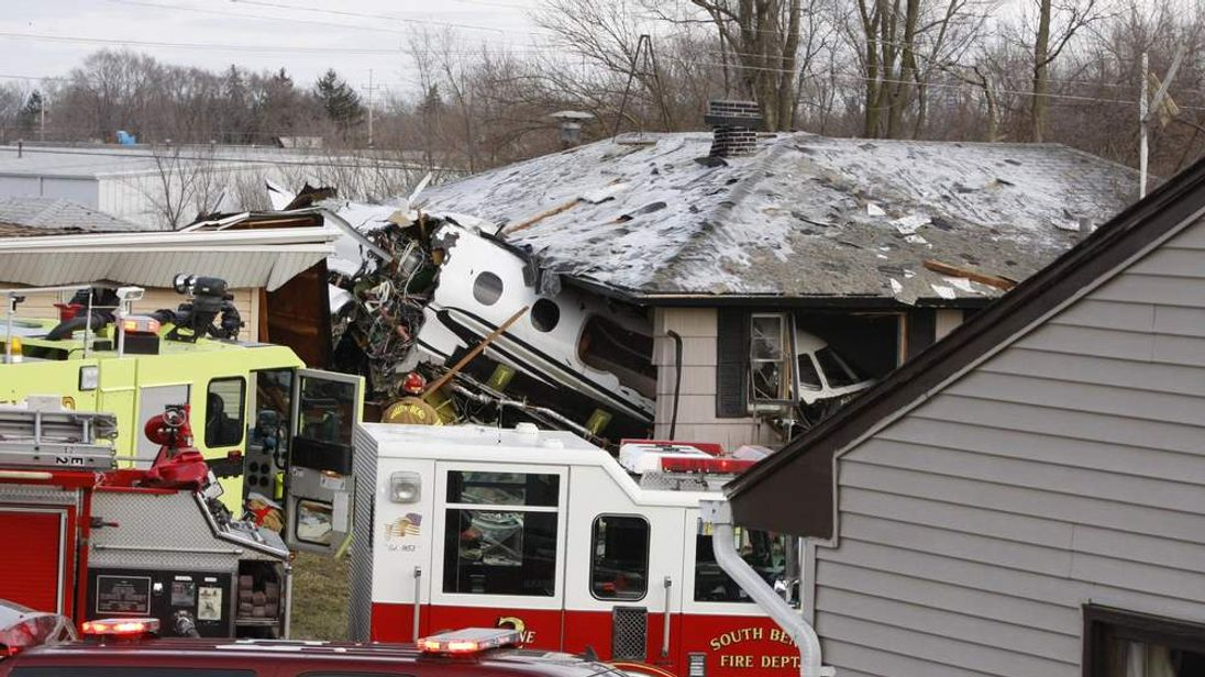 The front end of a jet sits inside a house in South Bend, Indiana