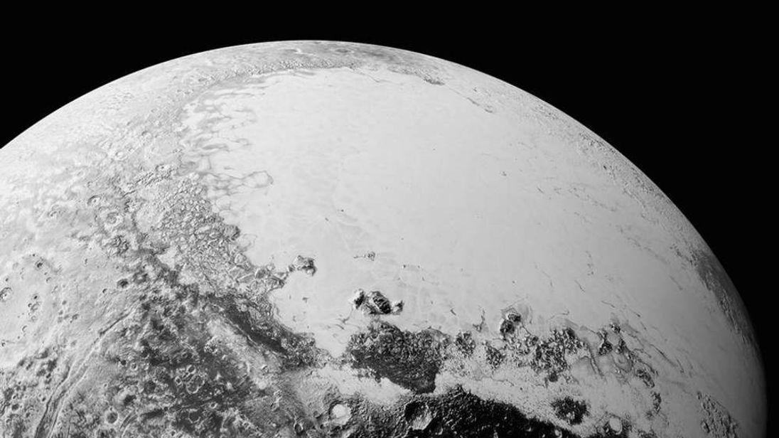 Image of Pluto's equatorial area showing icy plains in the northeast