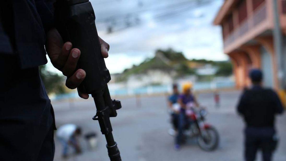 Police patrol the streets of a gang ridden neighbourhood in Tegucigalpa