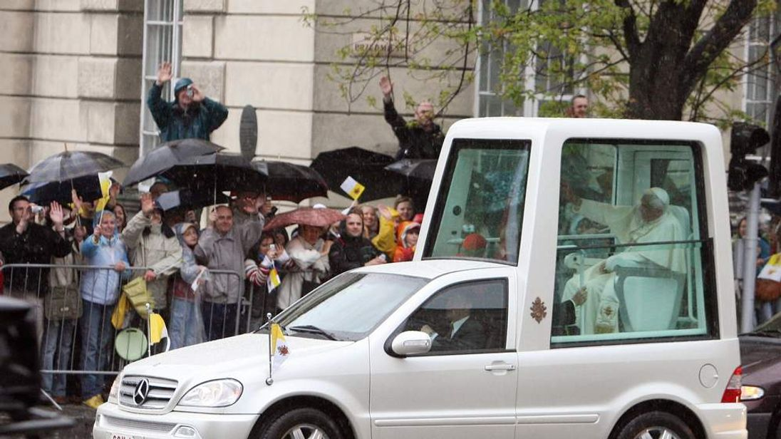 The pope travels to meet his followers in the pope mobile.