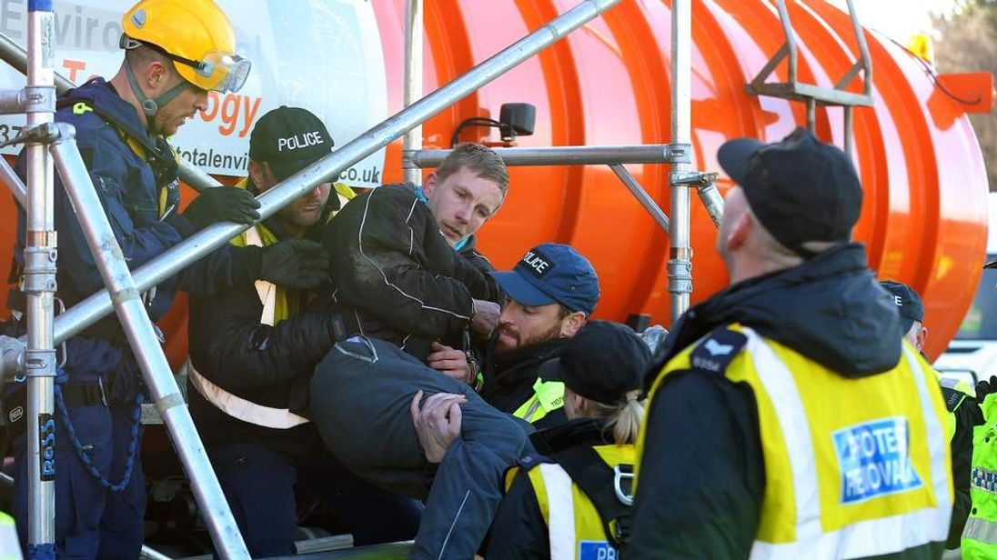 Police remove an anti-fracking protester