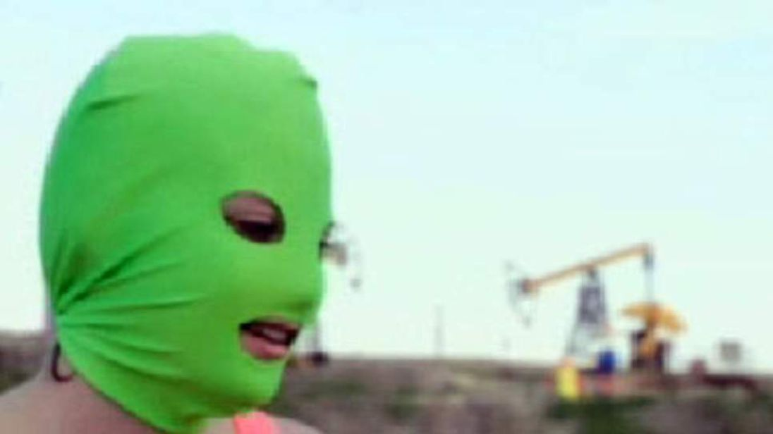 Pussy Riot member disguised under green balaclava