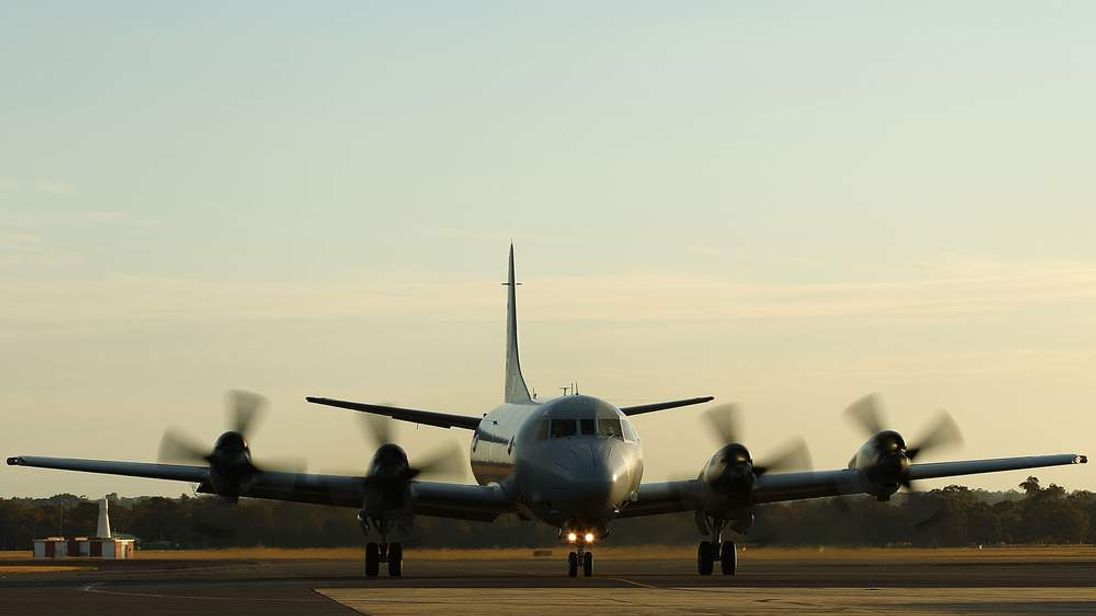 An RAAF Orion P-3 Takes off from an airbase in Perth