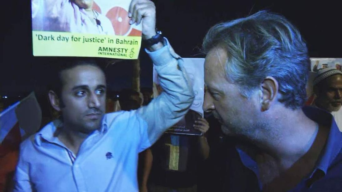 Bahrain: Protesters with Sky's Stuart Ramsay