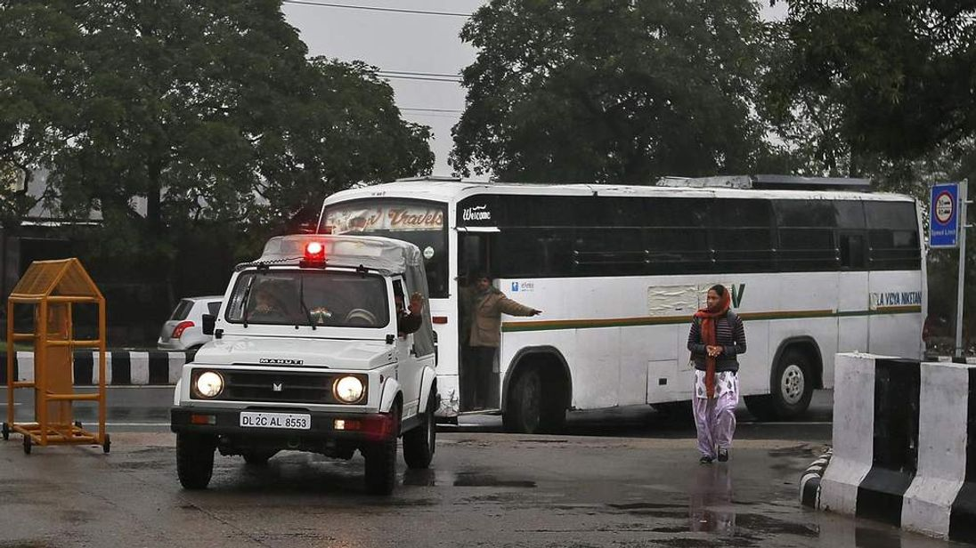 Police bring the bus on which the alleged gang rape of a student in India took place.