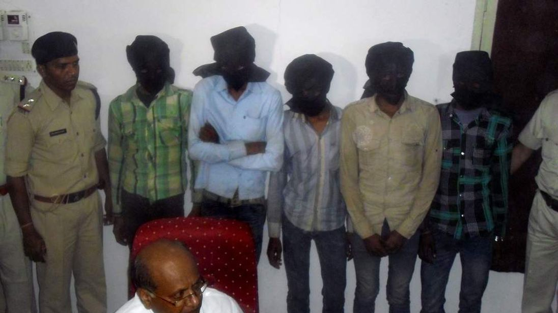 Five hooded suspects