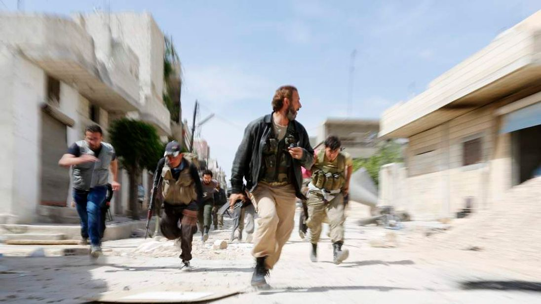 280514 $$ Obama Walks Tightrope In Foreign Policy Reset Syria Rebels
