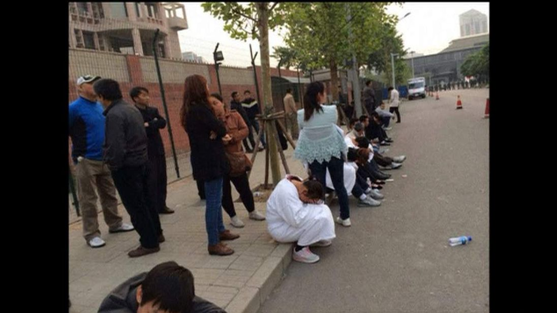 Relatives of those missing protest in Beijing