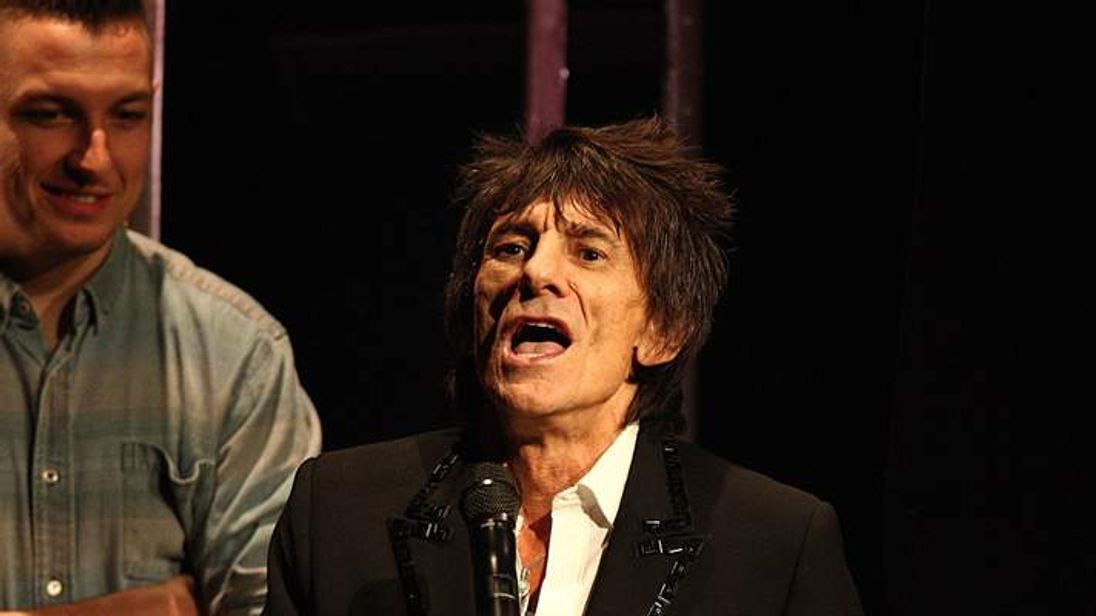 Ronnie Wood collecting the award for Best Live Band on stage during the 2013 NME Awards