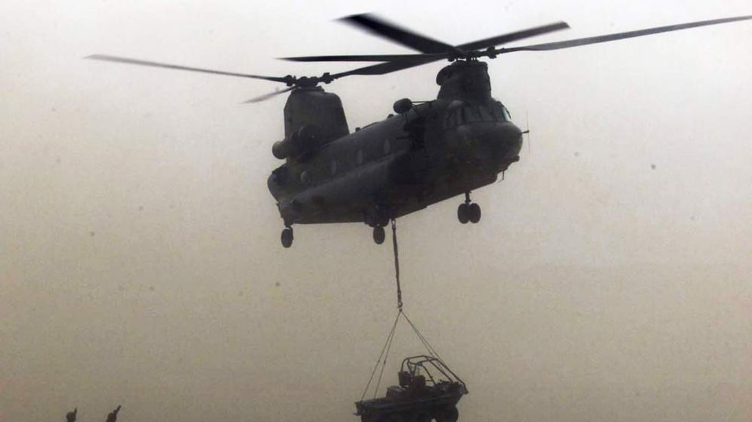 BRITISH MARINES BRING IN EQUIPMENT TO CAMP TAYLOR IN AFGHANISTAN.