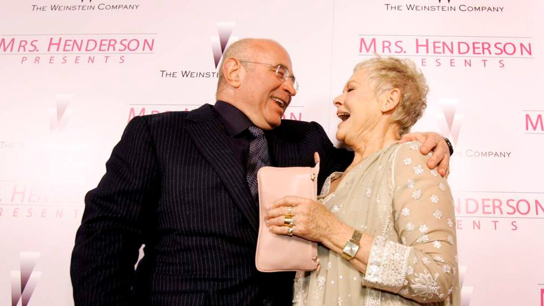 "Cast member Dench laughs with co-star Hoskins at premiere of ""Mrs Henderson Presents"" in Beverly Hills"