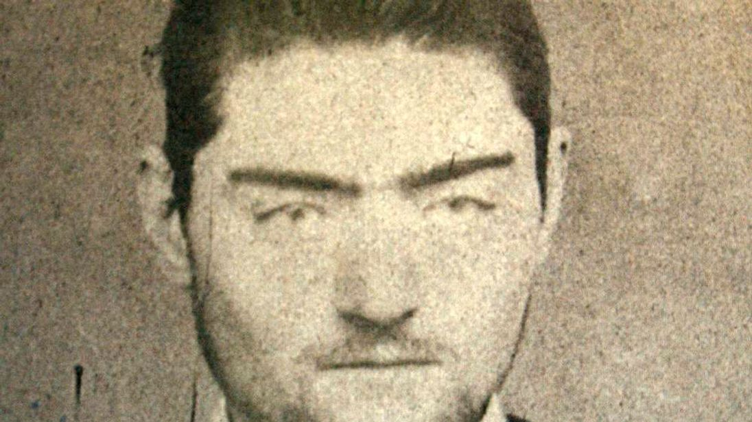 A photograph of a police mugshot of Ned Kelly, aged 16, at the Old Melbourne Gaol