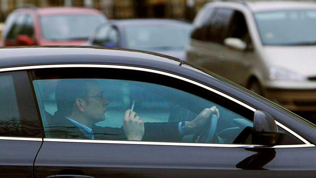 MPs have voted to ban smoking in cars with children.