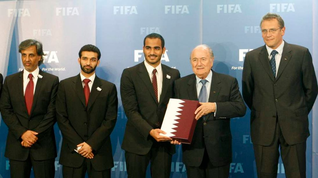 Sheikh Mohammed bin Hamad al Thani, chairman of the Qatar 2022 bid committee submits the official bid book for the 2022 Soccer World Cup to FIFA President Blatter in Zurich