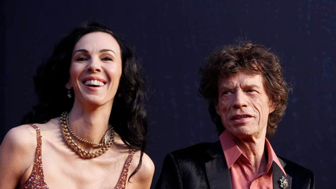 Rock musician Mick Jagger and model L'Wren Scott arrive at the 2011 Vanity Fair Oscar party in West Hollywood