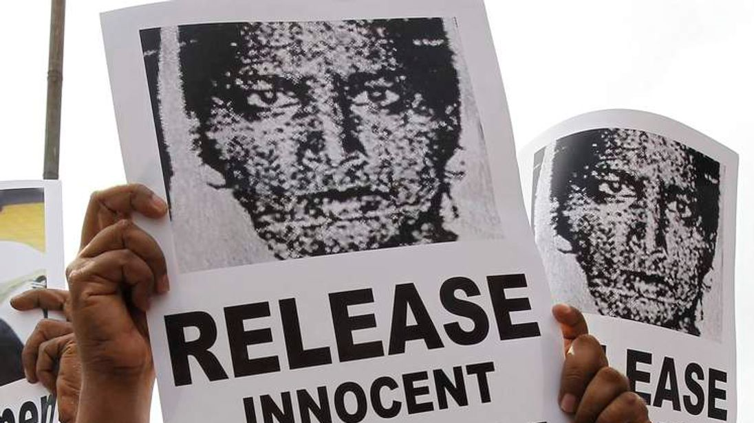 Demonstrator holds image of Nafeek, jailed in Saudi Arabia on charges of murder, during protest demanding her release in Colombo