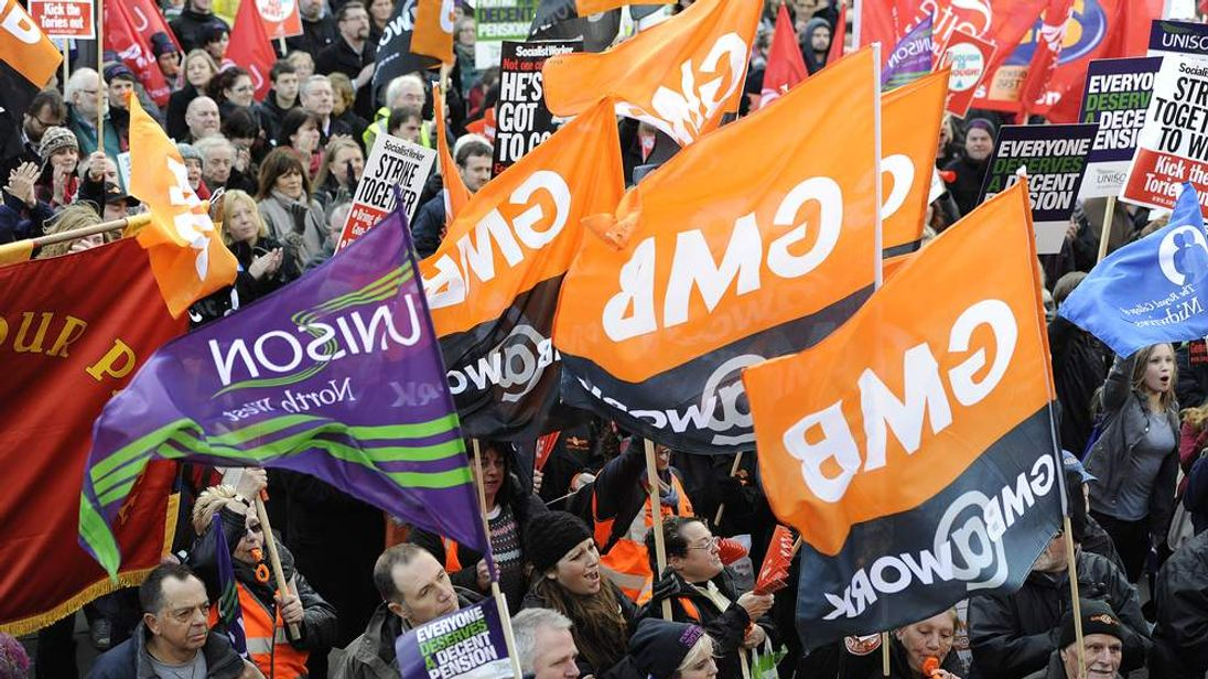 Public service union demonstrators take part in a protest march in Leeds in 2011