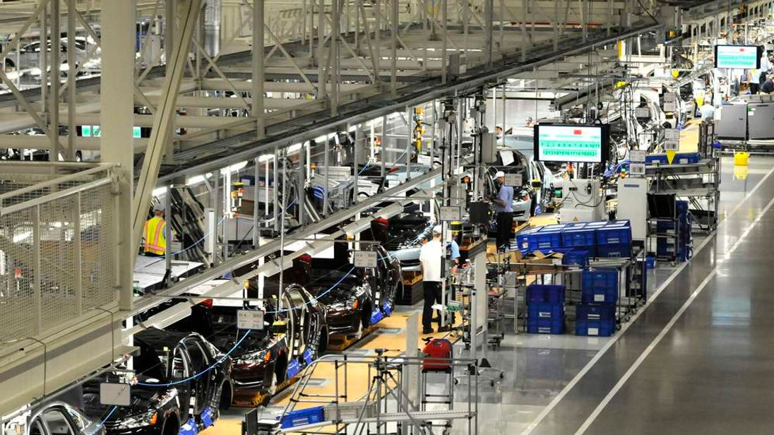 Volkswagen employees work on the assembly line of the 2012 VW Passat in Chattanooga Tennessee