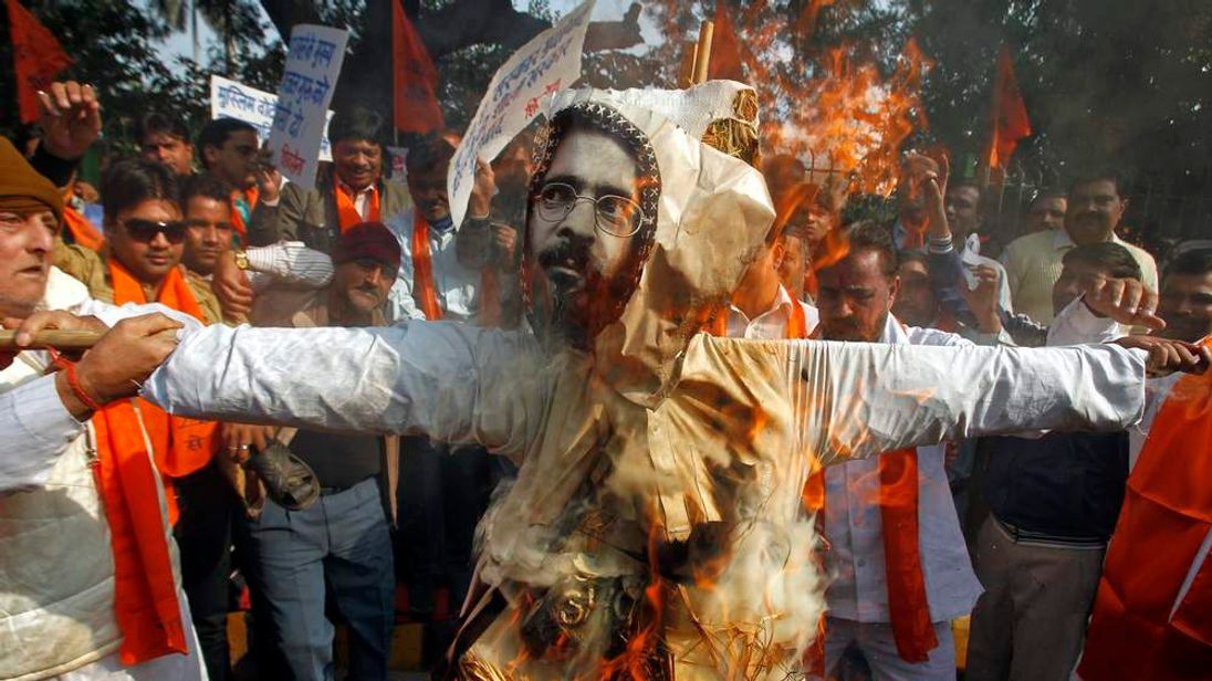 Activists from Hindu right-wing group Shiv Sena burn an effigy depicting Afzal Guru during a protest in New Delhi