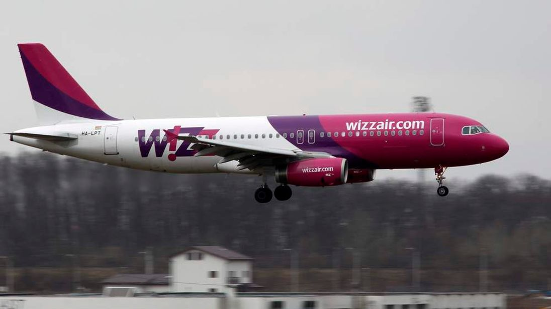 A Wizz Air Airlines Airbus A320 plane lands at Henri Coanda Airport in Otopeni, near Bucharest