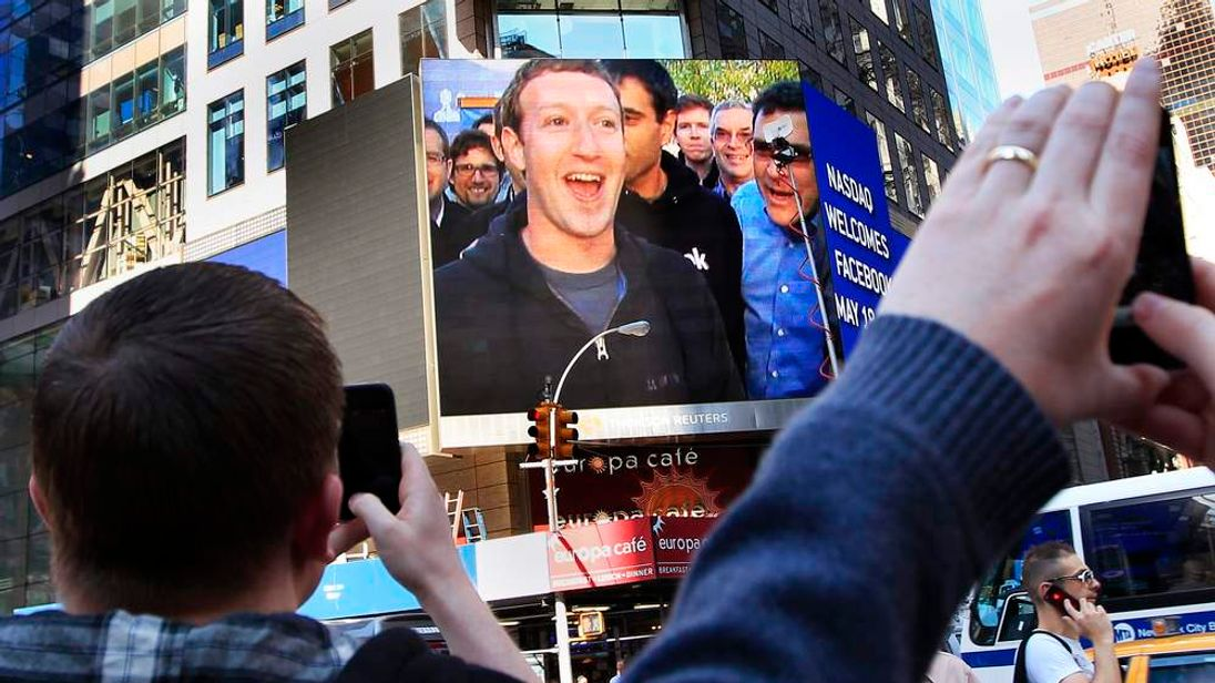 Mark Zuckerberg is seen on a screen televised