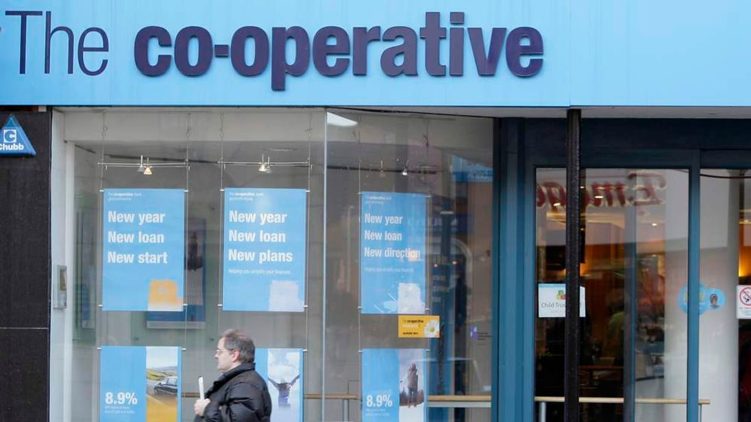 File photographs show a branch of a Lloyds TSB bank in London and a branch of the Co-operative bank in Northampton