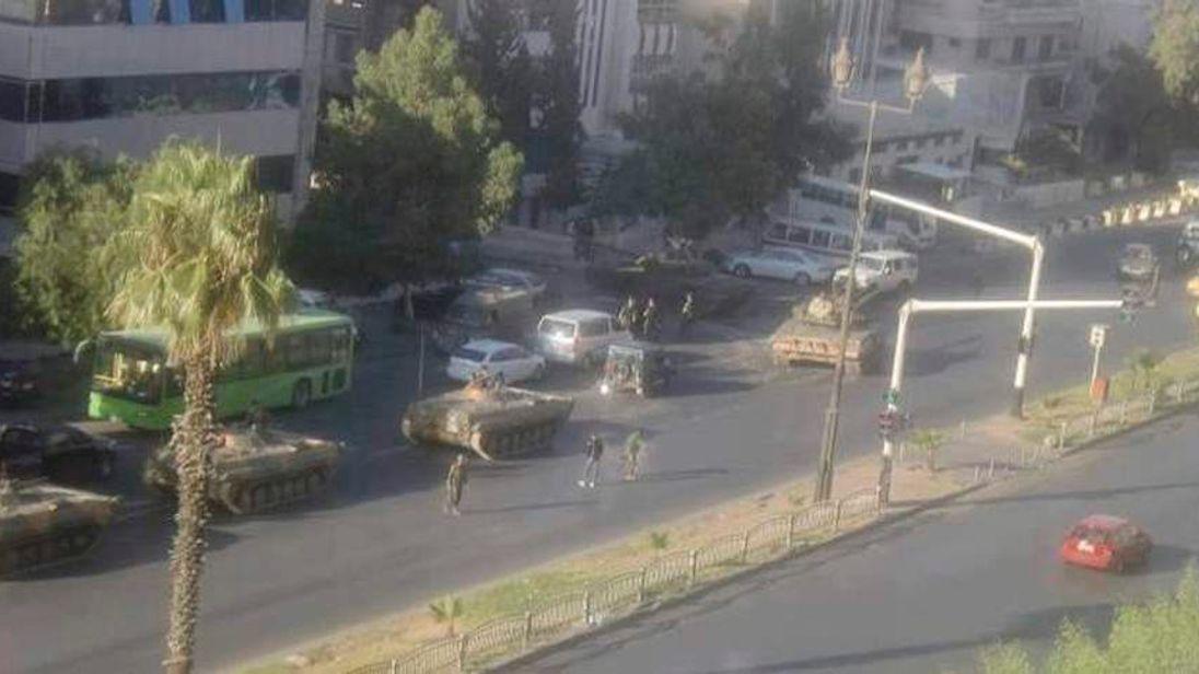 Tanks loyal to Syria's President Bashar al-Assad are seen at Al Mezza in Damascus