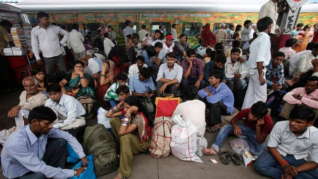 Rail passengers wait for the electricity to be restored at a railway station in New Delhi