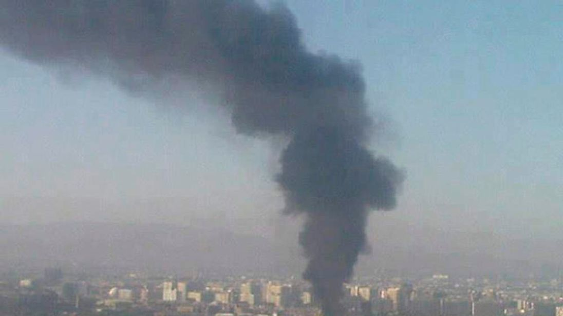 Black smoke billows after a bomb exploded at a military site near a hotel used by United Nations monitors in Damascus August 15, 2012.