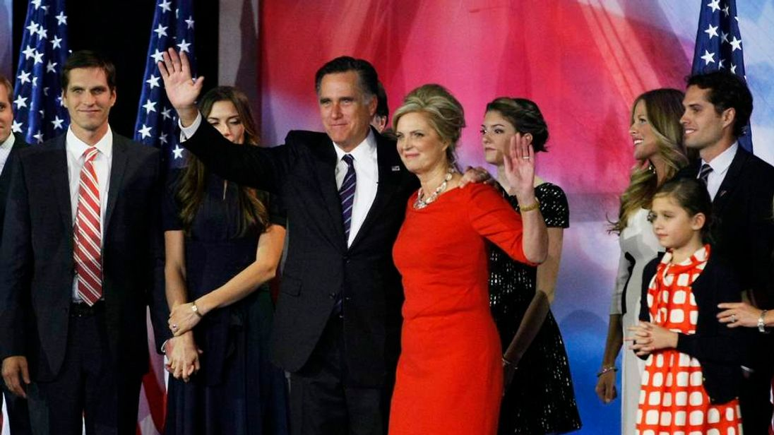 U.S. Republican presidential nominee Mitt Romney stands on stage with his wife Ann during his election night rally in Boston, Massachusetts.