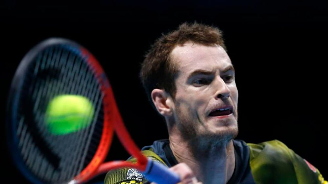 Andy Murray hits a return to Roger Federer during their semi-final match at the O2 Arena