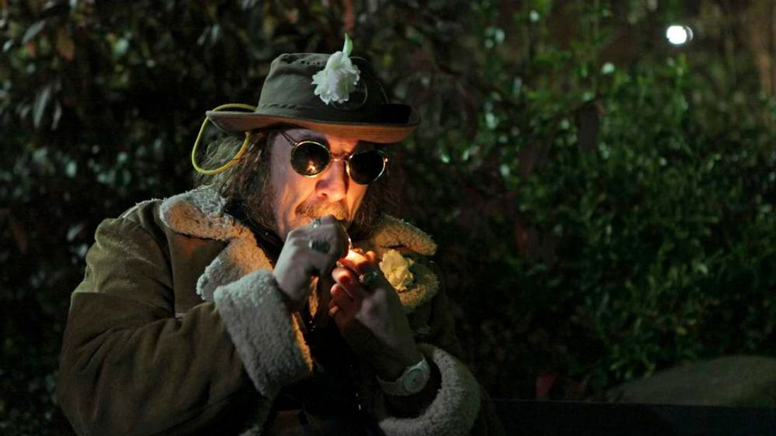 "A man, who identified himself as ""Professor Gizmo,"" lights up a pipe minutes before the law legalizing the recreational use of marijuana went into effect in Seattle, Washington"