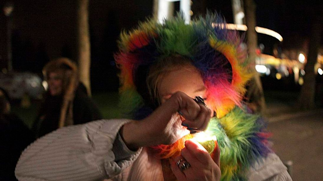 """A woman, identified only as """"Hurricane,"""" lights up after the law legalizing the recreational use of marijuana went into effect in Seattle, Washington"""