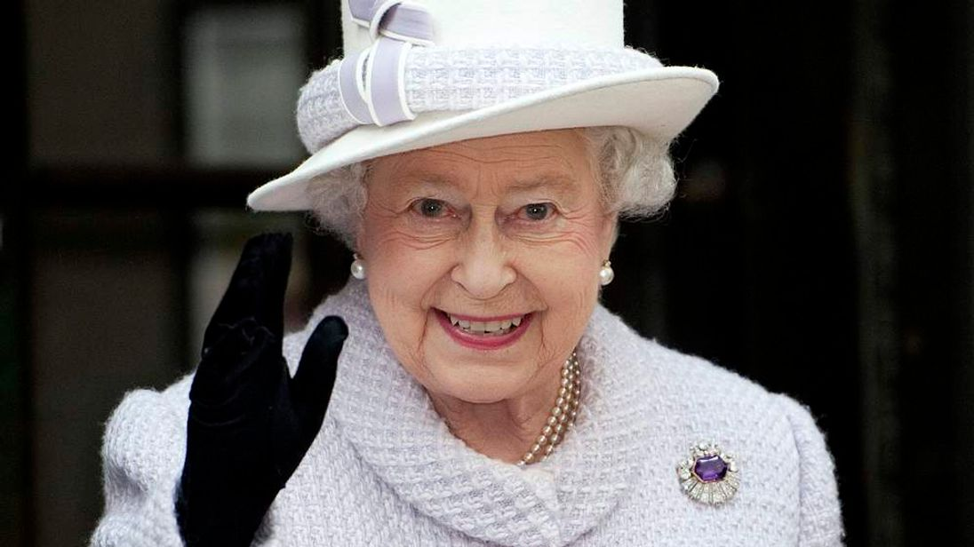 Britain's Queen Elizabeth waves during a visit to the Bank of England in the City of London