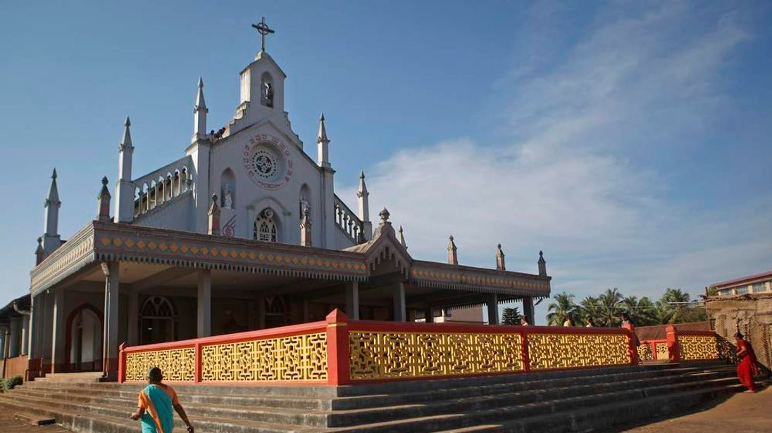 People arrive for mass at a church where the last rites for nurseJacintha Saldanha  would be performed in Shirva