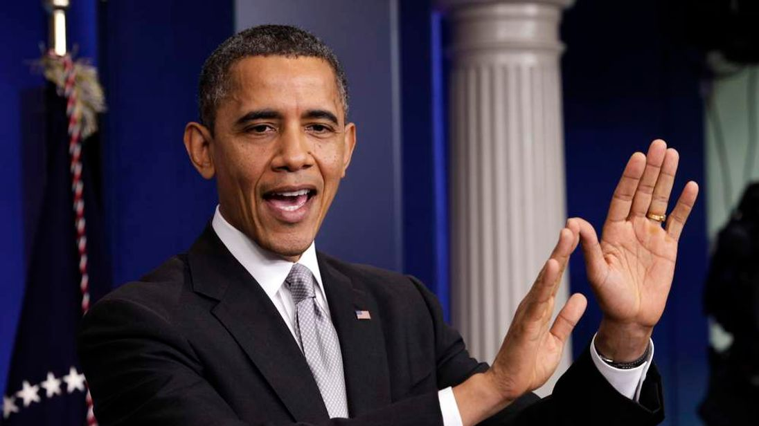 "U.S. President Obama gestures as he speaks to the media about the ""fiscal cliff"" in Washington"
