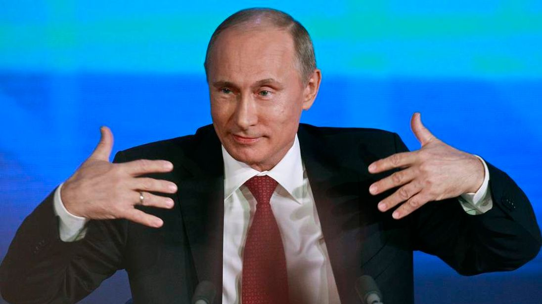 Russia's President Vladimir Putin gestures during his annual news conference in Moscow
