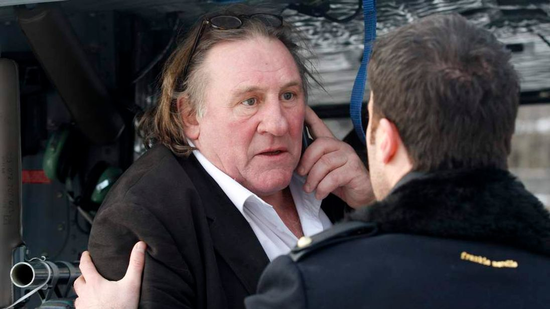 French actor Depardieu  talks on the phone after visiting Cetinje