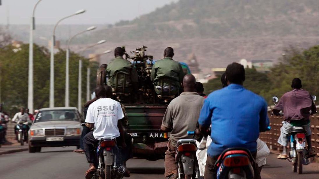 Malian soldiers drive on the streets of the capital Bamako