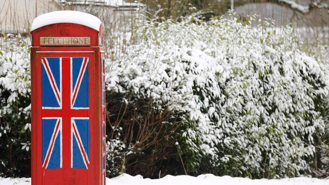 An old telephone box in the snow at Staplefield in south east England