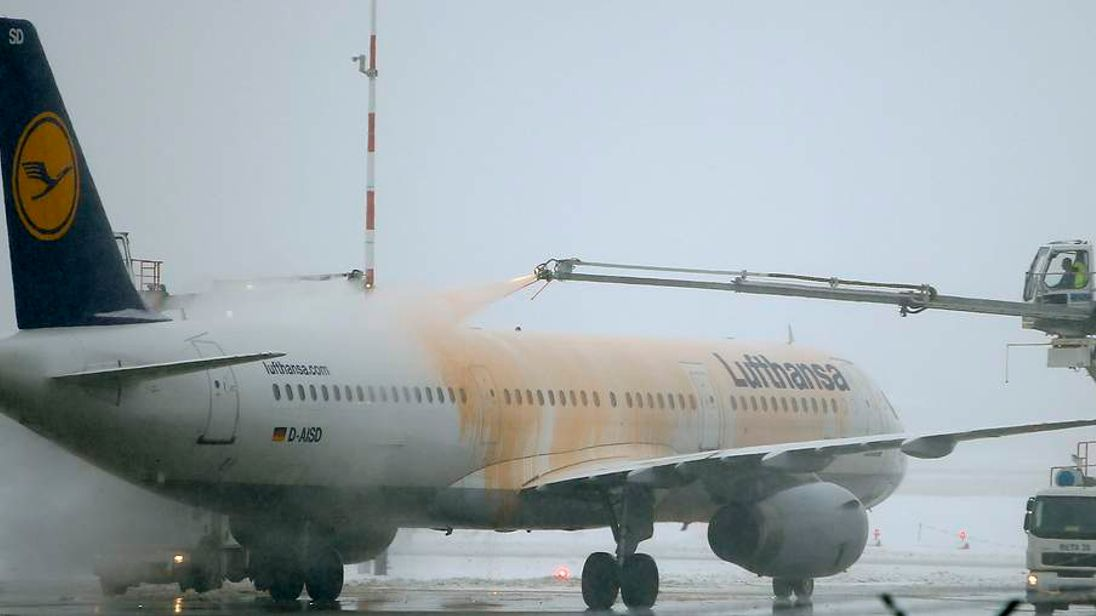 A Lufthansa airplane is defrosted at the Fraport airport in Frankfurt