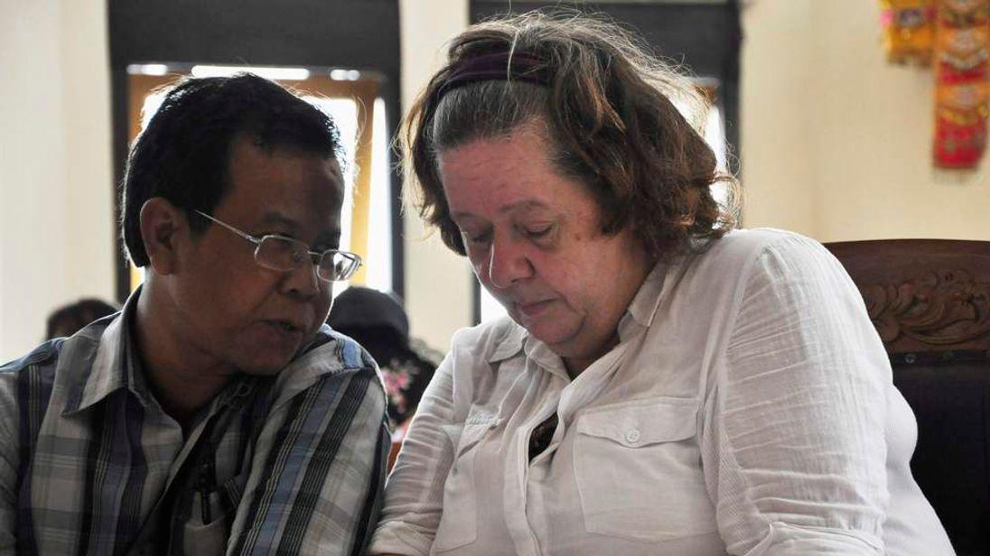 Sandiford listens to her translator during her trial in Denpasar in Bali