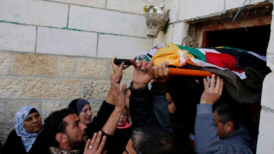 Palestinians carry the body of Lubna Hanash during her funeral in Bethlehem