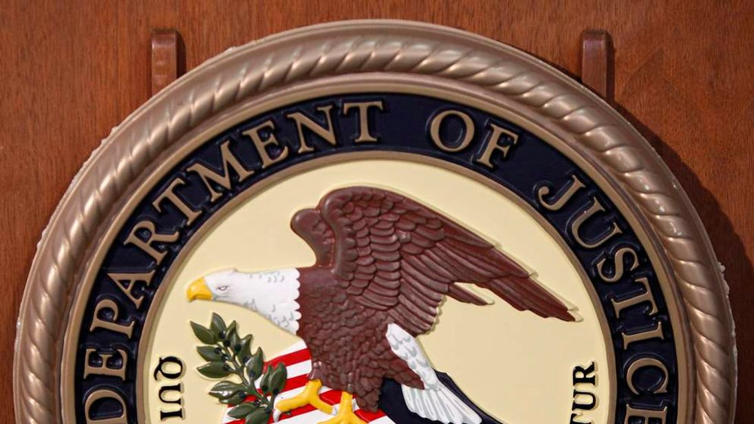 The Department of Justice logo is seen on the podium during a news conference on the Gozi Virus in New York