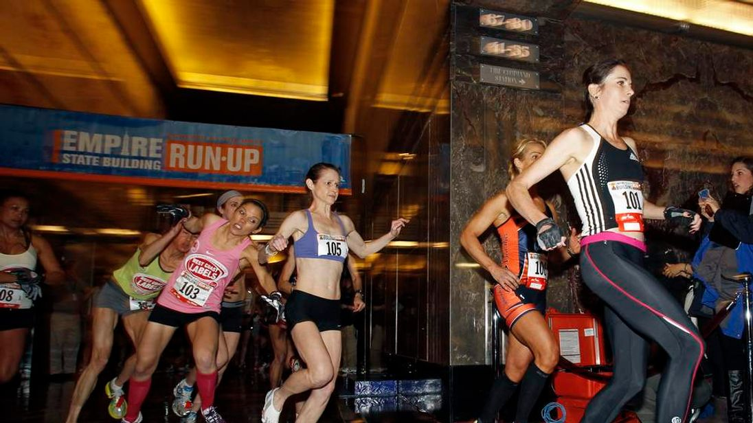 The women's invitational runners participate during the start of the 36th Empire State Building Run-Up running race in New York